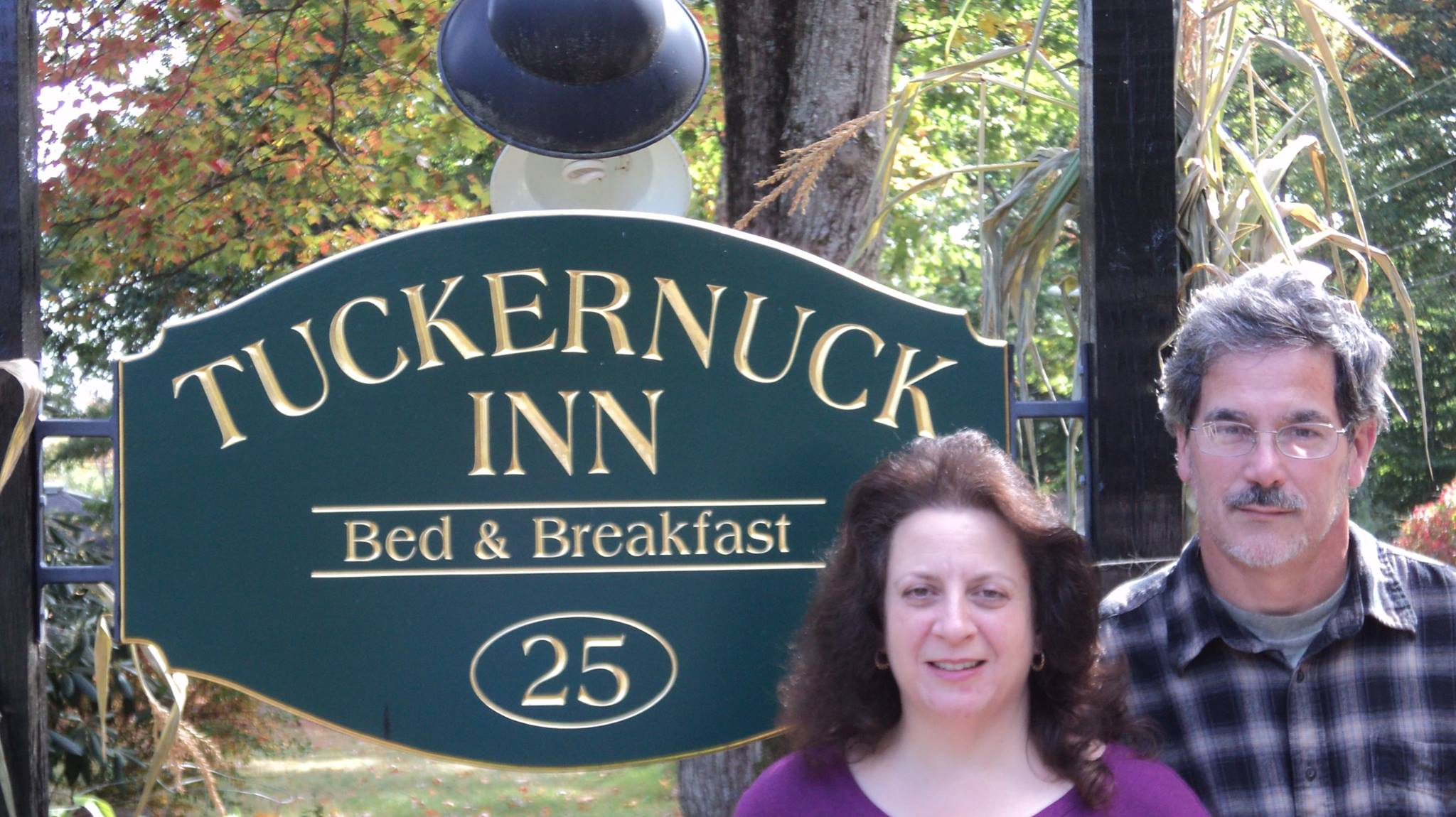Tom and Ann Infront of Tuckernuck Sign 2014